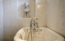 Pretty ensuite with rolltop bath