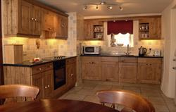 Oak kitchen with granite worktops