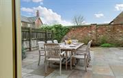 Barn House courtyard garden with table