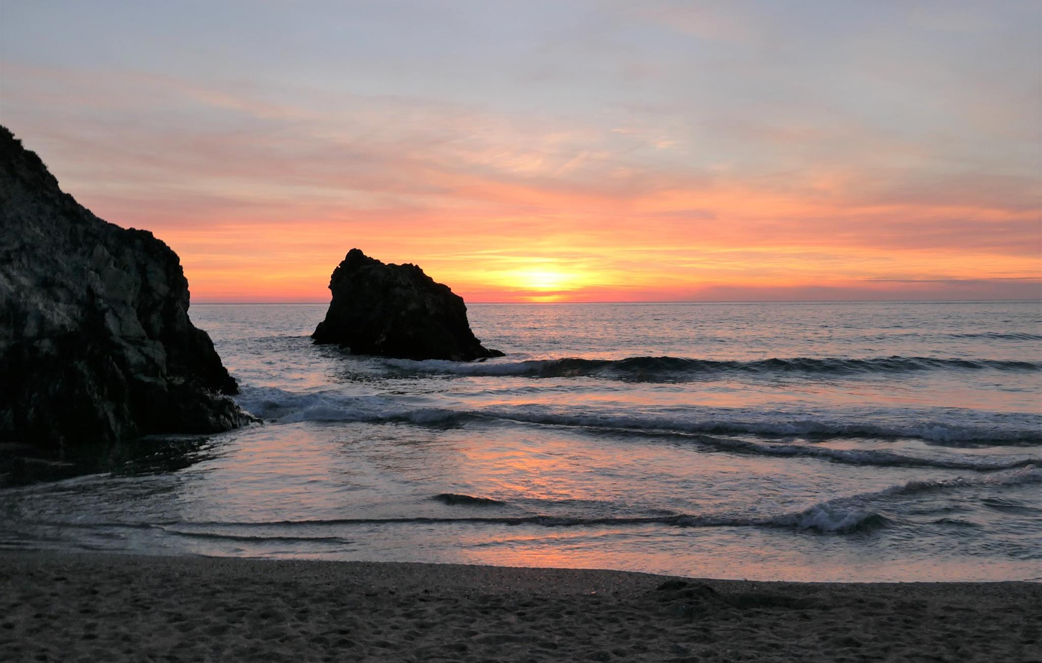 Catch a stunning sunset at Holywell Bay