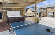 Table tennis and hot tub overlooking the courtyard