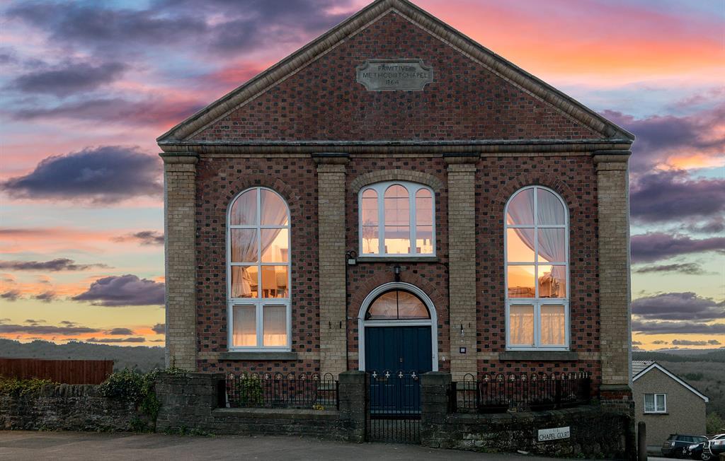Historic 1864 Primitive Chapel Facade at Dusk