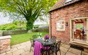 Private garden with table, BBQ stand and lawn