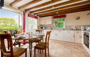 Forge dining kitchen with french doors