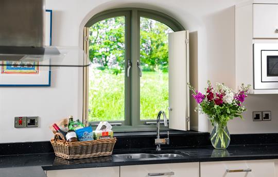 Hayloft Kitchen window overlooking meadow HighBarn