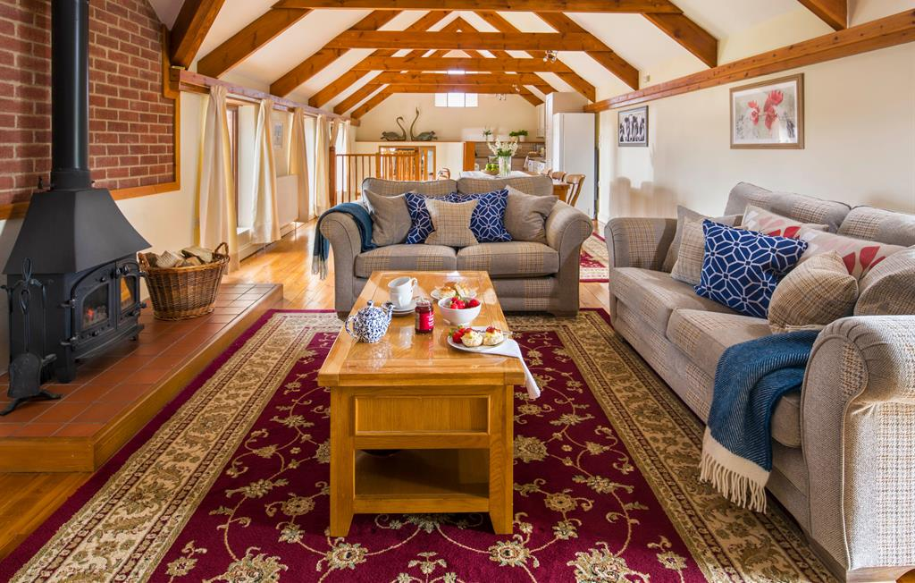 Rafters living room with cosy log burner