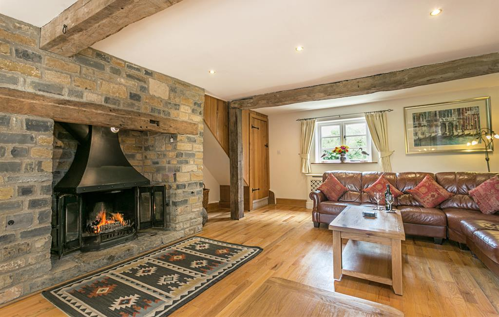 Stone Inglenook with wood burner - logs provided