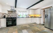 Modern kitchen slate floors and granite worktops