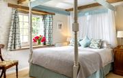 Master bedroom with a lovely four poster bed