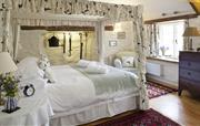 Bedroom with four poster, double bed