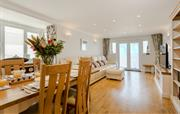 Open plan lounge/dining with balcony doors