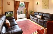 Sitting room with doors leading to patio