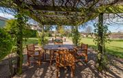 Take a seat, relax in the spacious walled garden