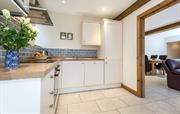 Kitchen, leading through to dining and lounge.