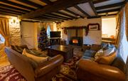 Cosy living room with roaring log burner