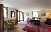 Stables dining room with wood burner