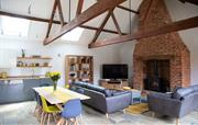 Large open plan living space with woodburner