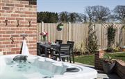 Patio and hot tub at The Burrows