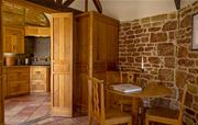 Dining area and kitchen in Hazelnut cottage