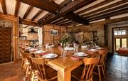 Dining room with handmade oak table seating 18