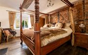 Stunning master bedroom with four-poster bed