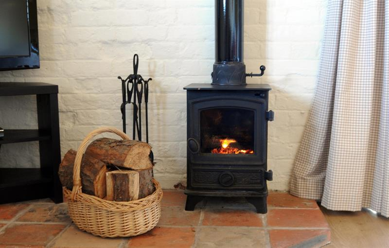 Cosy woodburner in Wagtail Cottage