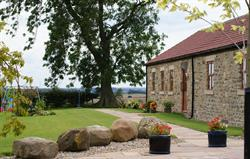 side of The Byre and garden