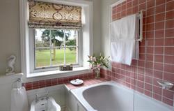 En-suite with shower over bath