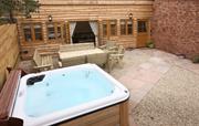 Hot tub and patio at Lavender Barn