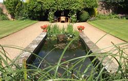 Walled garden has ponds & fountains