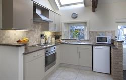 The kitchen with granite worktops