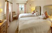One of 3 twin bedrooms