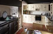 Spacious kitchen with large aga