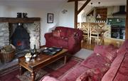 Orchard lounge with log burner