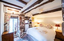 Romantic beams and kingsize bed