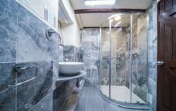 Recently fitted marble shower room