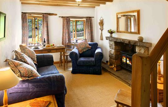 Comfortable sitting room with log burner