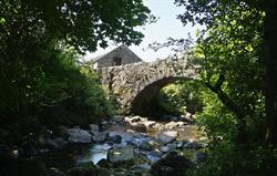 Whillan Beck Cottage beyond bridge