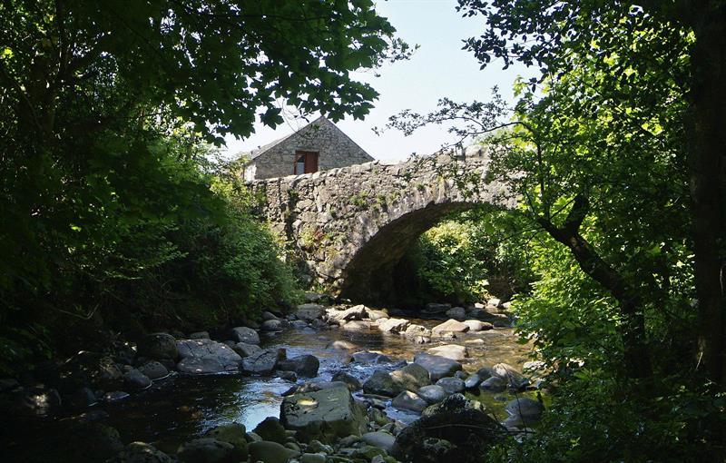 Whillan Beck Cottage beyond bridge