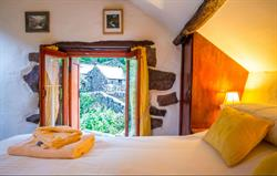 Romantic kingsize bed with views