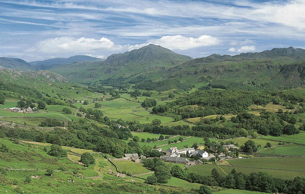 Bridge End Farm Cottages in the foreground, located in Boot Village in the glorious Eskdale Valley