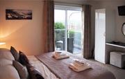 Bedroom 1 with ensuite and balcony