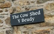 The Cow Shed sign
