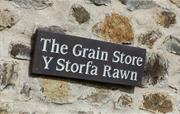 The Grain Store sign