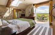 Master bedroom in The Cow Shed