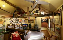 Fabulous games room huge log burner