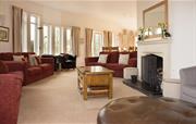 Comfy, large, curvaceous lounge