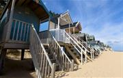 Beach huts and sand