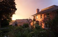 Setting sun over the cottages