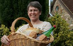 Rachel with hamper of local produce